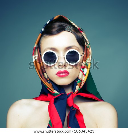 Studio photo of the girl in sunglasses and a scarf fun - stock photo