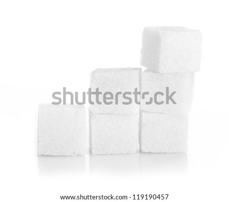 Studio photography of a lump sugar pile in light back - stock photo