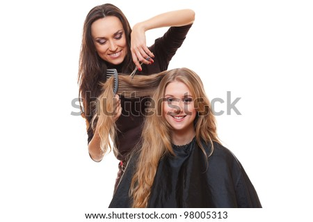 studio picture of hairdresser and smiley woman. white background - stock photo