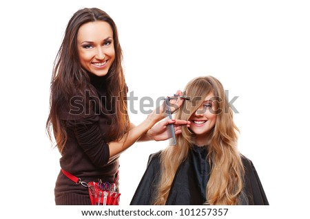 studio picture of hairdresser doing haircut. isolated on white - stock photo