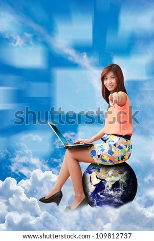 Studio portrait lady on globe on the cloud : Elements of this image furnished by NASA - stock photo