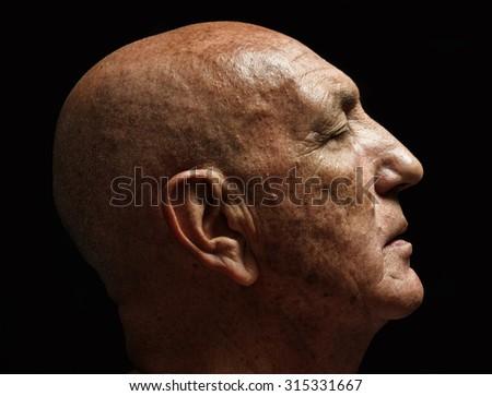 studio portrait of a bald old man - stock photo
