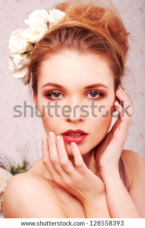 Studio portrait of a beautiful blond girl - stock photo