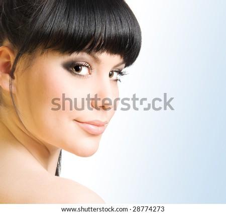 Studio portrait of a beautiful brunette - stock photo