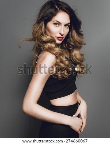 Studio portrait of a beautiful fashion girl in profile - stock photo