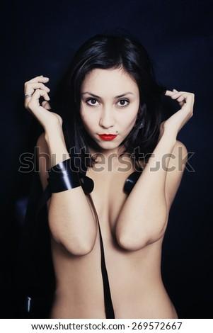 Studio portrait of a beautiful young asian woman closeup - stock photo