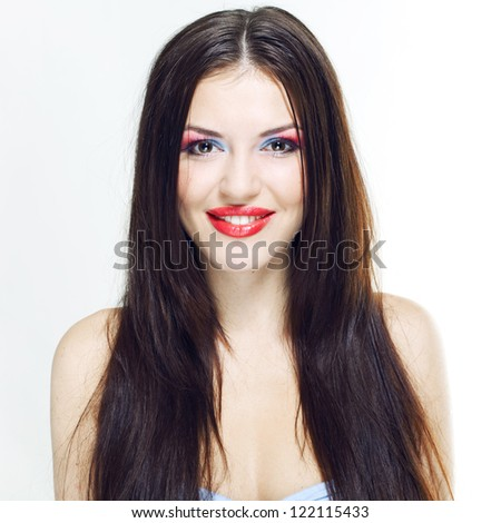 Studio portrait of a beautiful young brunette on a white background. Professional make-up. - stock photo