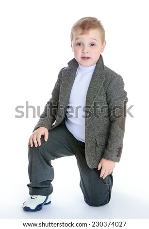 Studio portrait of a boy in a gray suit.baby fashion concept - little boy in a gray suit. - stock photo