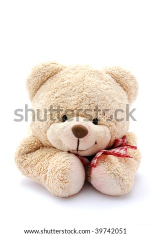 Studio portrait of a cute beige teddy bear for kids with happy smiling facial expression. Image isolated on white background. - stock photo