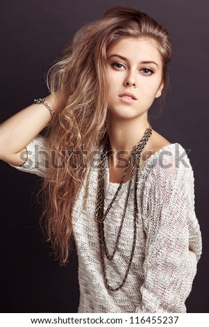 Studio Portrait of a girl with curly hair - stock photo