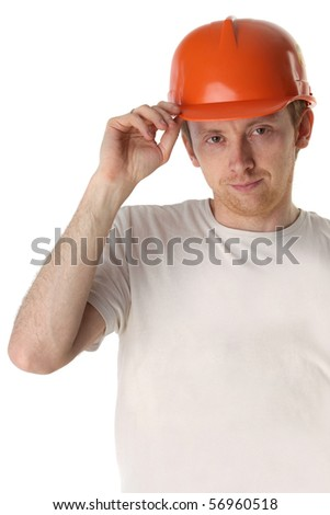 Studio portrait of a happy handyman in orange helmet - stock photo