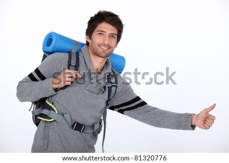 Studio portrait of a hitchhiker - stock photo