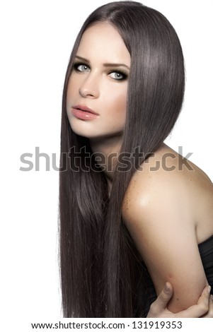 Studio portrait of a model showing her healthy shining hair - stock photo