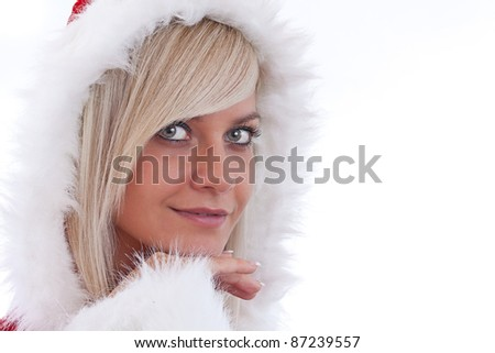 studio portrait of a sexy young blonde woman dressed as Santa - stock photo