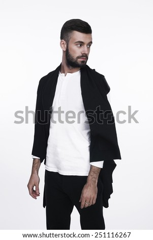 Studio portrait of a stylish man in trend clothes and trendy hairstyle. Isolated on white background. - stock photo