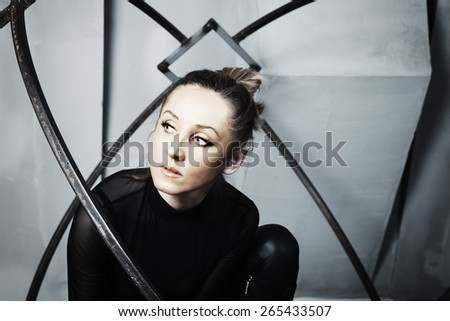 Studio portrait of a young actress with bronze makeup - stock photo