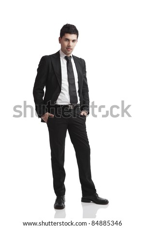 Studio portrait of a young businessman isolated over a white background - stock photo