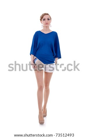 Studio portrait of a young woman with a purse waolking forward, isolated on white background - stock photo