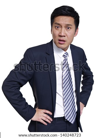 studio portrait of an angry asian businessman - stock photo