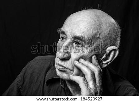 Studio portrait of an old man - stock photo