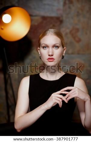 Studio portrait of attractive young nordic type woman in makeup. - stock photo
