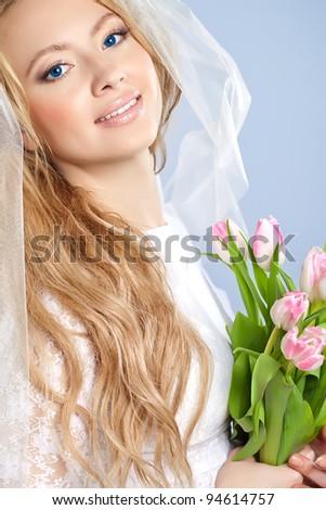 Studio portrait of beautiful bride - stock photo