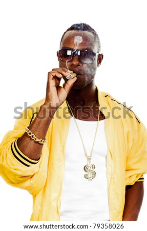 Studio portrait of cool black gangster rapper with yellow jacket, sunglasses and cigar. Isolated on white background. - stock photo