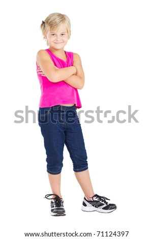 studio portrait of cute little girl standing on white - stock photo