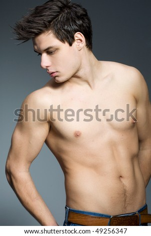 Studio portrait of handsome man - stock photo
