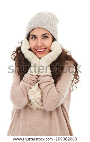 Studio portrait of happy young woman in winter clothing looking away isolated on white background - stock photo