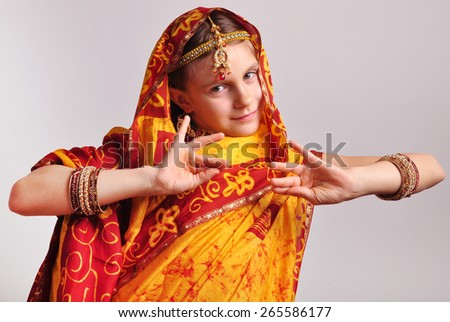 studio portrait of little girl in traditional Indian clothing and jeweleries - stock photo
