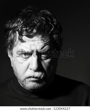 Studio portrait of middle age man - stock photo