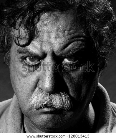 Studio portrait of middle aged man, black and white - stock photo