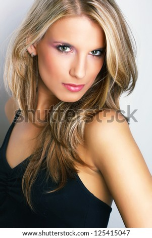 Studio portrait of pretty young woman - stock photo