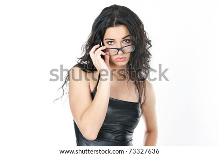 studio portrait of sad young attractive woman wearing glasses - stock photo