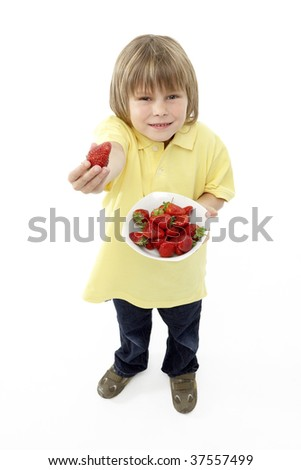 Studio Portrait of Smiling Boy Holding Bowl of Strawberries - stock photo