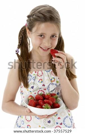 Studio Portrait of Smiling Girl Holding Bowl of Strawberries - stock photo