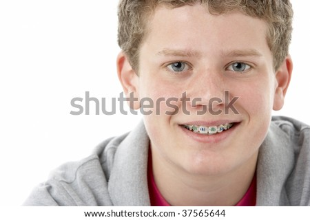 Studio Portrait of Smiling Teenage Boy - stock photo