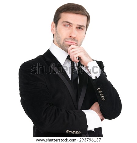 Studio portrait of thinking young business man. Black suit and tie. Isolated over white background - stock photo