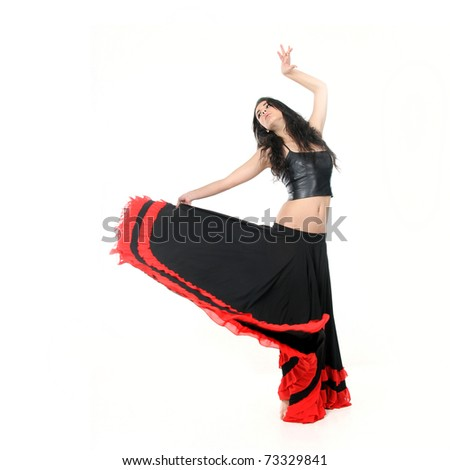 studio portrait of young attractive woman dancing flamenco - stock photo