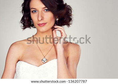 studio portrait of young beautiful bride - stock photo