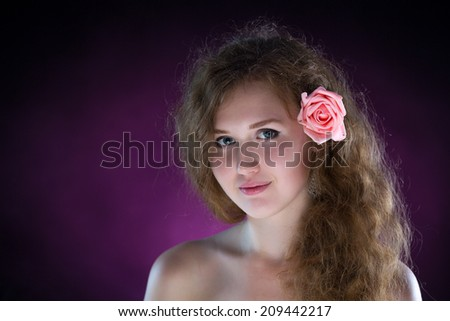 Studio portrait of young beautiful woman with roses in the smoke - stock photo