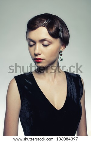 Studio portrait of young girl - stock photo