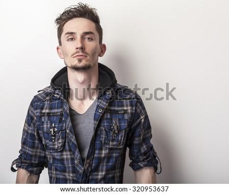Studio portrait of young handsome man in stylish dark blue jacket.  - stock photo