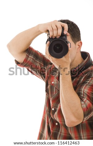 Studio portrait of young man taking picture over white - stock photo