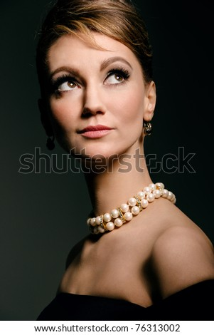 studio portrait of young woman, classic retro styling - stock photo