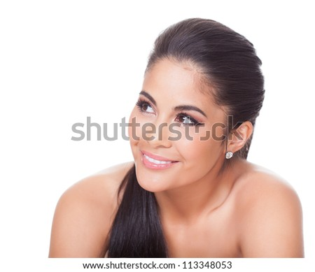 Studio portrait on white of a beautiful smiling woman with her eyes raised as she looks off into the distance - stock photo