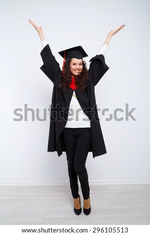 Studio portrait picture from a young graduation woman - stock photo