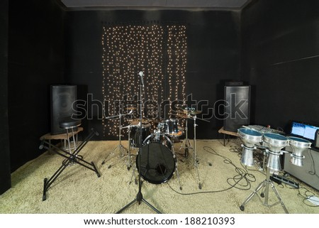Studio room with drum set, microphones and recording equipment. - stock photo