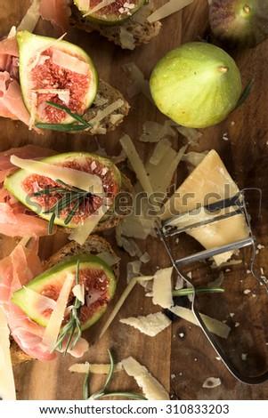 Studio shoot on Bruschetta with ham figs and cheese - stock photo